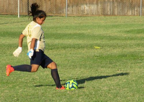 girl soccer kick