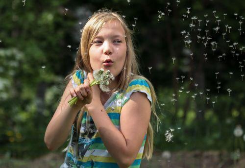 girl dandelion blow