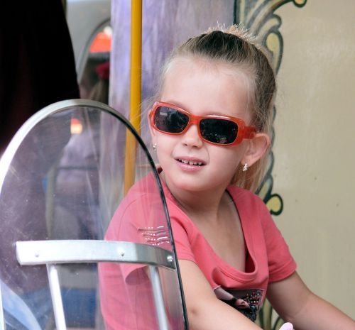girl sunglasses funfair