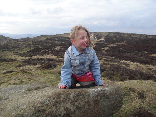 girl sitting windy