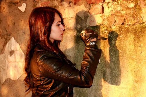 girl leather jacket knife