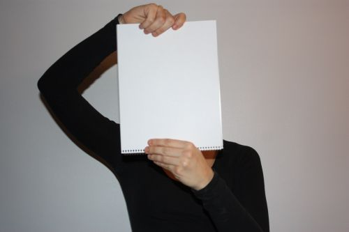 Girl And Blank Paper