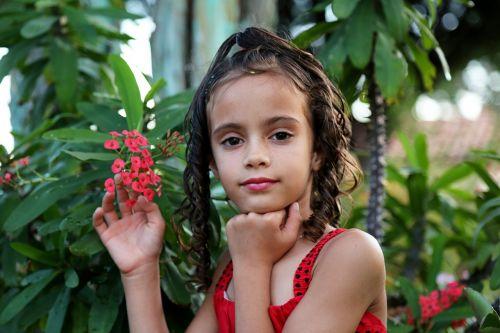girl holding flower girl in the garden model