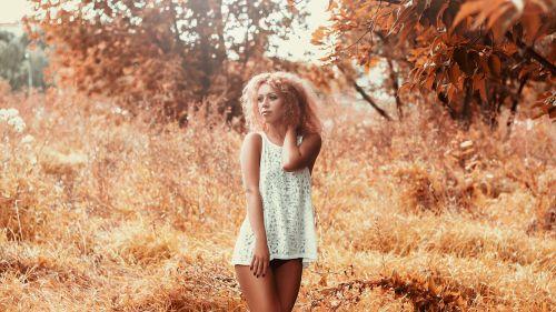 girl in a short dress on the field legs