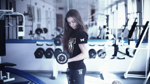 girl in the gym training apparatus kickboxing
