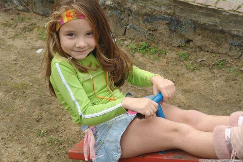 girl on a swing denim skirt a smile