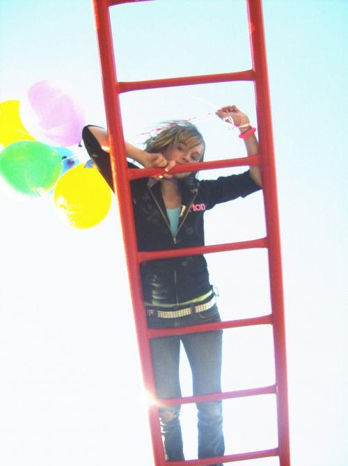girl on ladder balloons ladder