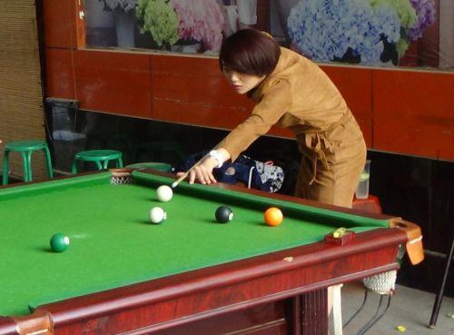 Girl Shooting Pool