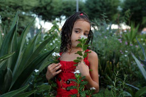 girl smelling a flower girl in the garden model