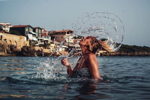Girl Splashing Hair In The Sea