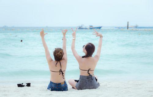 girls looking at the sea pattaya thailand
