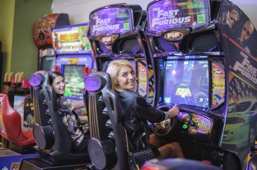 girls playing car game