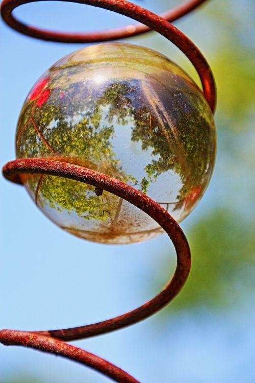 glass ball mirroring topsy-turvy world