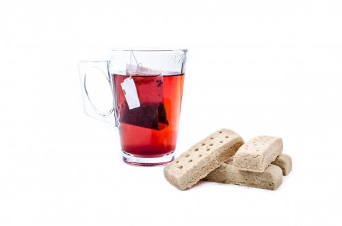 Glass Cup With Tea Bag And Wafers