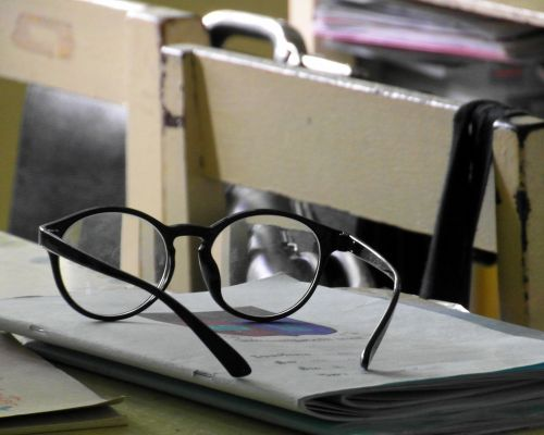 Glasses On A School Desk