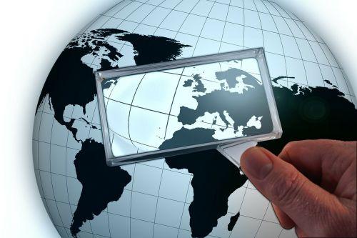 globe earth magnifying glass