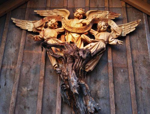 glory to god angel carved