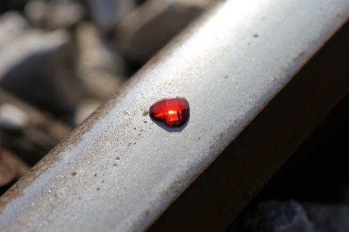 glowing red heart on railway stop children suicide stop teenager suicide