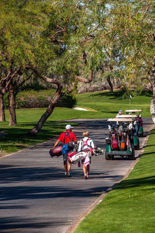 golfers golf carts pathway