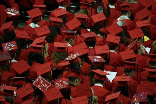 graduates graduation cap and gown