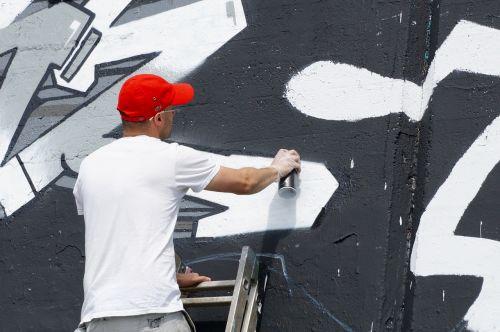 graffiti sprayer wall