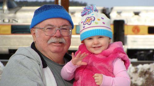 grandpa granddaughter snow