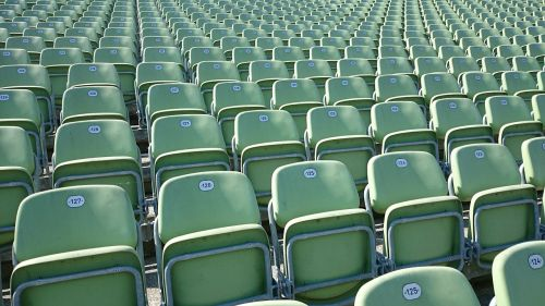 grandstand audience sit