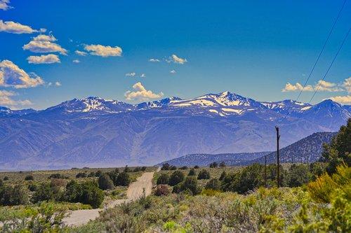 gravel road  mountains  desert
