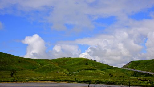 Green Hills And Cloudy Sky