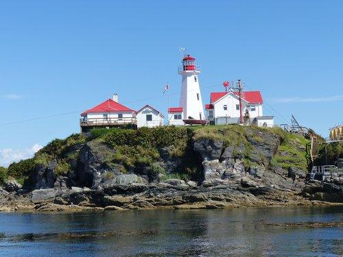 green island  lighthouse  warning sign