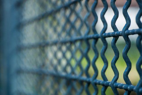 grid fence imprisoned