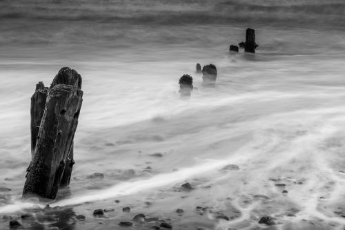groynes wave breaks seascape