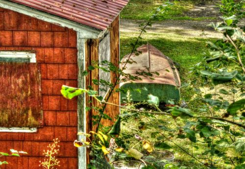 Grunge Cabin And Rowboat