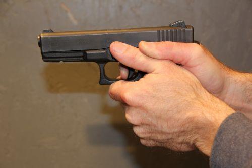 gunpoint handgun firearm