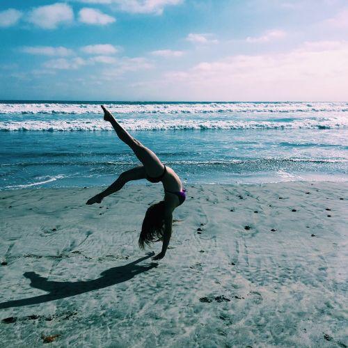 gymnastics beach ocean
