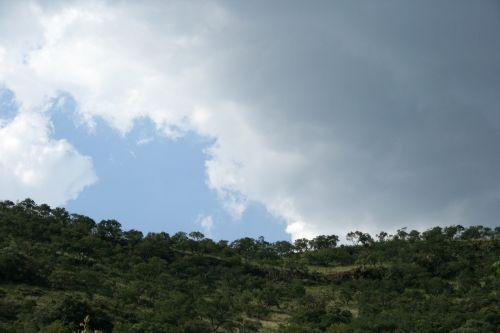 Half Dark Cloud Over Hill