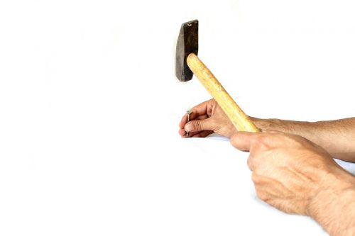 hammer,employee,white,stone,man,chisel,sledgehammer,background,overalls,one,tool,driving,hit,adult,hand,younge,work,building,happy,caucasian,sledge,people,isolated