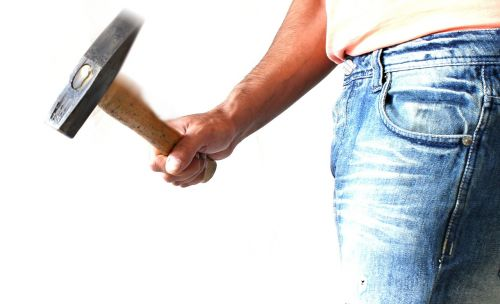 hammer,employee,white,stone,man,chisel,sledgehammer,background,overalls,one,tool,driving,hit,adult,hand,younge,work,structural,happy,caucasian,sledge,people,isolated