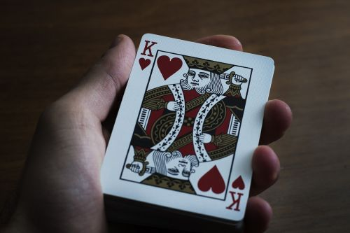 hand playing cards paper