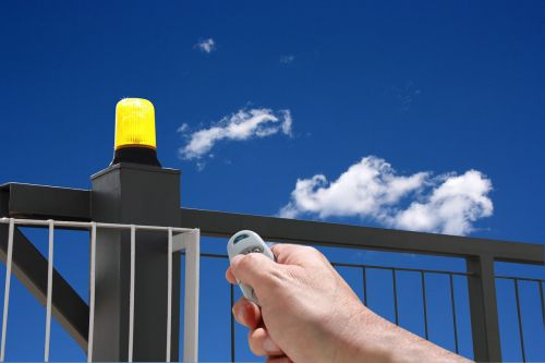 hand with remote control automatic gate gate opening