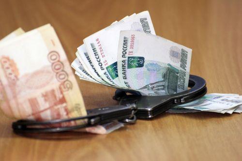 handcuffs money corruption