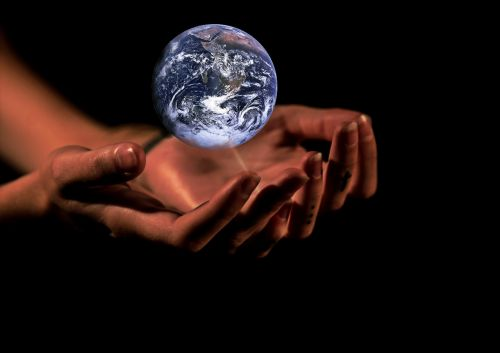hands globe earth