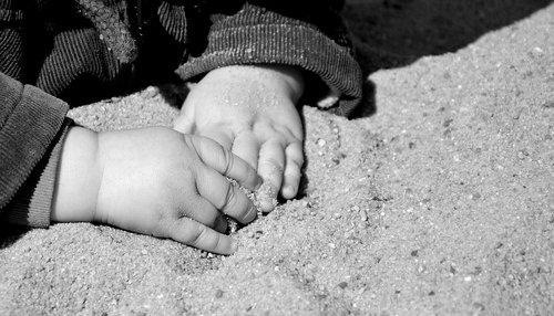 hands  children's hands  sand