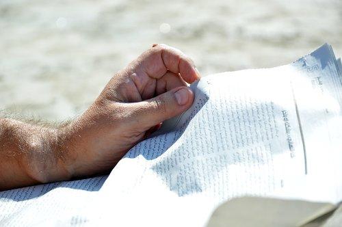 hands  newspaper  read