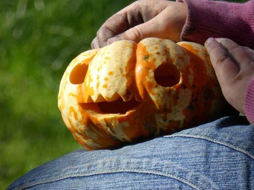 hands dirty pumpkin