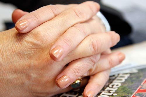 hands adult folded