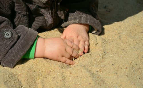 hands children's hands sand