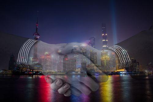 handshake,business,hand,business handshake,shake,shanghai,china,international business,international trade,night,harbour,city,agreement,contract,skyline