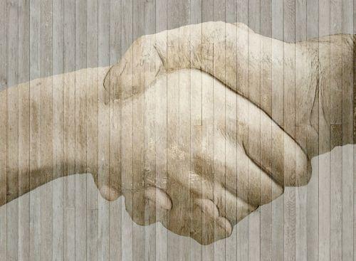 handshake hands wood