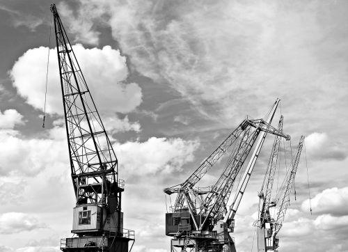 harbour cranes sky clouds